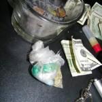 Bag of marijuana, crack pills, partially smoked marijuana cigars inside the glass container, and liquid PCP inside